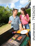 happy couple cooking meat on... | Shutterstock . vector #79226236