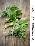 fresh herbs on wooden surface | Shutterstock . vector #79227058