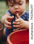 child's hands playing in garden ... | Shutterstock . vector #792296197