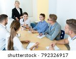 group of attentive students and ... | Shutterstock . vector #792326917