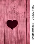 Heart Carved In A Red Wooden...