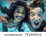 happy couple underwater | Shutterstock . vector #792343915