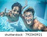 happy couple underwater | Shutterstock . vector #792343921
