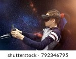 the boy plays on the simulator... | Shutterstock . vector #792346795