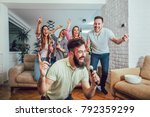 group of friends playing... | Shutterstock . vector #792359299