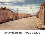 Small photo of Abandoned houses of a street deserted in the saltpeter Humberstone, old ghost town used to obtain infinite products derived from saltpeter, Atacama desert, northern Chile