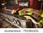 firefighter gear and helmet | Shutterstock . vector #792381031