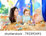 little child and their mother... | Shutterstock . vector #792392491