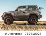 white dirty jeep on road. | Shutterstock . vector #792410029