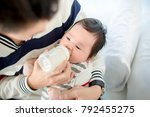 dad feeding her baby daughter...   Shutterstock . vector #792455275