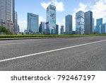 empty asphalt road with city...   Shutterstock . vector #792467197