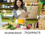 smiling asian female florist... | Shutterstock . vector #792499675