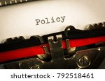 "Small photo of Vintage typewriter ""Policy"""