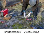 welder makes a fence in the... | Shutterstock . vector #792536065