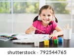 little girl is painting picture | Shutterstock . vector #792544765