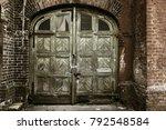 old wooden door in poor quarter....   Shutterstock . vector #792548584