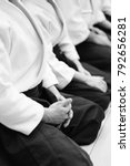 Small photo of Sensei students sitting in a row on the mat at a seminar on aikido