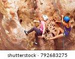 rock climbers climbing up the... | Shutterstock . vector #792683275