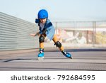 boy riding on roller skates at... | Shutterstock . vector #792684595