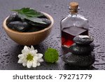 balance stones, a bowl with stones, essential oil and flowers - stock photo