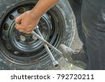 men are removing the wheels. | Shutterstock . vector #792720211