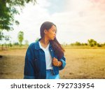 woman with dry field background ... | Shutterstock . vector #792733954