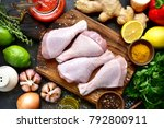 raw organic chicken legs with... | Shutterstock . vector #792800911