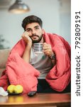 young ill man drinking hot tea... | Shutterstock . vector #792809191