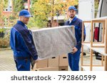 two young male worker in blue... | Shutterstock . vector #792860599