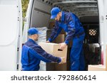 two young male movers carrying... | Shutterstock . vector #792860614