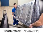 two young male movers in... | Shutterstock . vector #792860644
