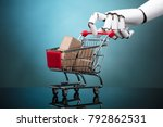 robot holding shopping cart... | Shutterstock . vector #792862531