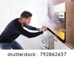 shocked man looking at burnt... | Shutterstock . vector #792862657