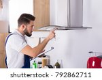male electrician with clipboard ... | Shutterstock . vector #792862711