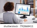rear view of a businesswoman... | Shutterstock . vector #792868411