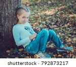 child walking in the park. | Shutterstock . vector #792873217