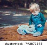 child walking in the park. | Shutterstock . vector #792873895