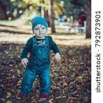 child walking in the park. | Shutterstock . vector #792873901