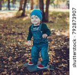 child walking in the park. | Shutterstock . vector #792873907