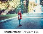 child walking in the park.   Shutterstock . vector #792874111
