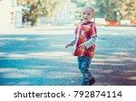 child walking in the park. | Shutterstock . vector #792874114