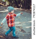 child walking in the park. | Shutterstock . vector #792874117