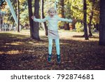 child walking in the park.   Shutterstock . vector #792874681