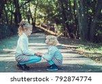 child walking in the park.   Shutterstock . vector #792874774