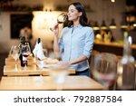 modern sommelier estimating... | Shutterstock . vector #792887584