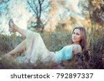 a beautiful girl is resting on... | Shutterstock . vector #792897337
