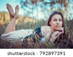 a beautiful girl is resting on...   Shutterstock . vector #792897391