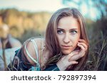 a beautiful girl is resting on... | Shutterstock . vector #792897394