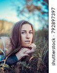 a beautiful girl is resting on... | Shutterstock . vector #792897397
