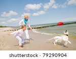 Stock photo summer vacation family with dog playing on the beach 79290904